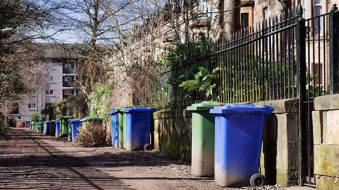 Household waste - wheelie bins along a street