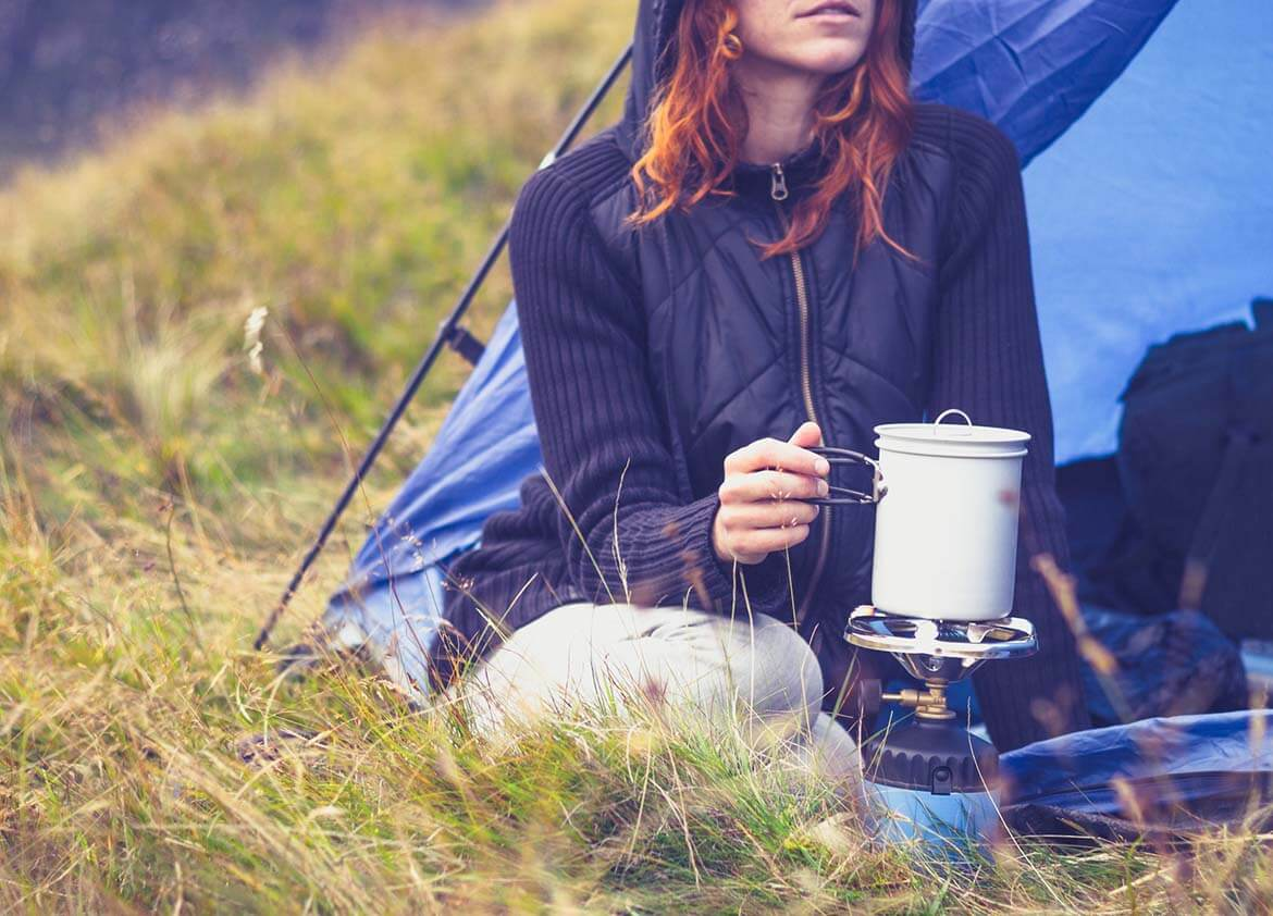 using a portable camping stove