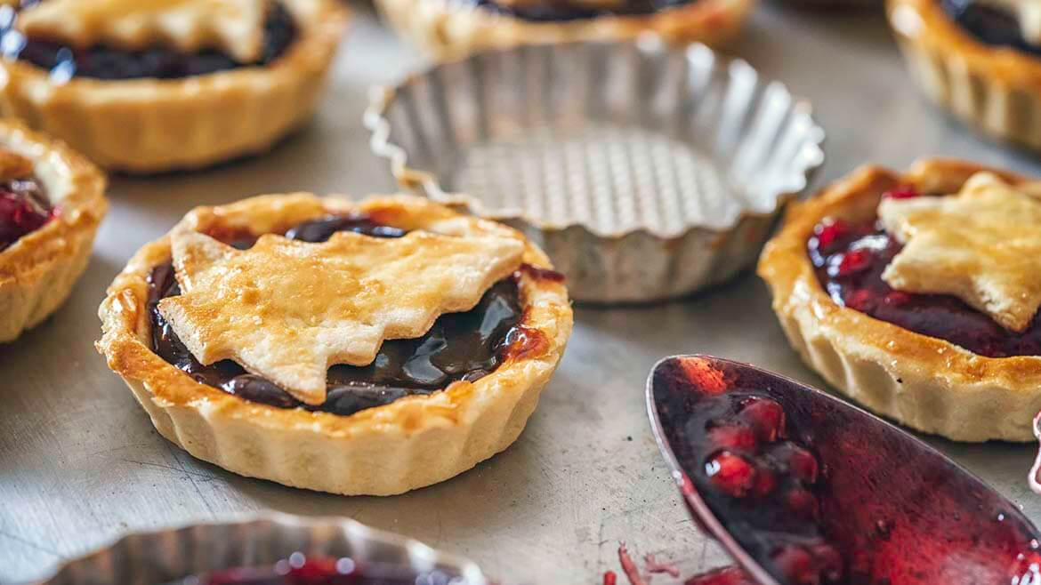 Christmas tarts and spoon with jam filling - homemade presents