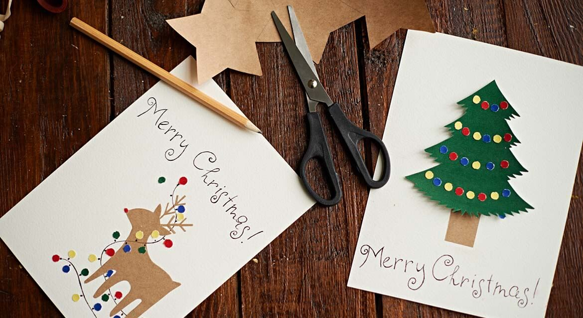 Homemade Christmas cards featuring a deer and Christmas tree